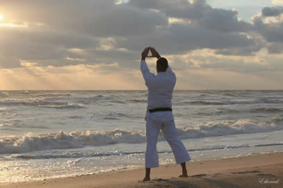 Sensei George Rego, FJJA Chief Instructor, practices the classical karate kata - Kanku (sky observation) during a 6am sunrise beach jujitsu & karate workout