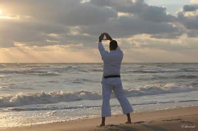 Sensei George Rego, FJJA Chief Instructor, practices the classical karate kata - Kanku (sky observation) during a 6am sunrise beach jujitsu & karate workout